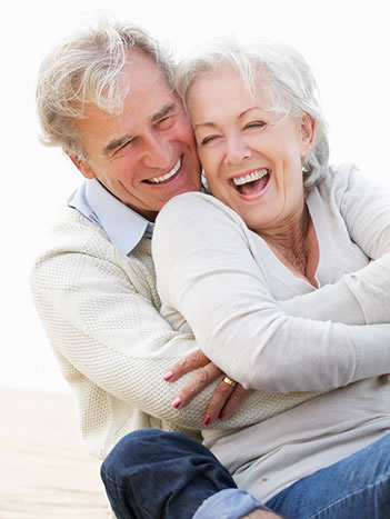 A smiling older couple with dentures