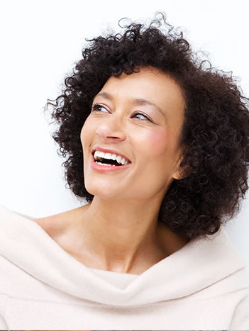 laughing woman with fillings that match her teeth