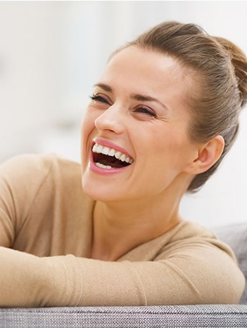 laughing woman who can rest at ease knowing that Kenmar Dental has oral cancer screening