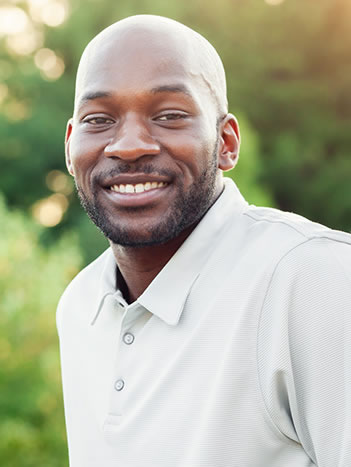 a smiling man with a healthy smile from using sealants