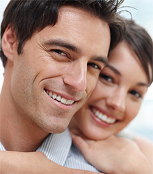 a couple with healthy smiles from common dental procedures