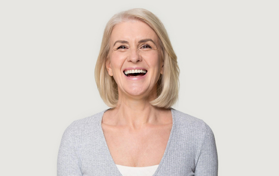laughing woman happy about affordable dental care
