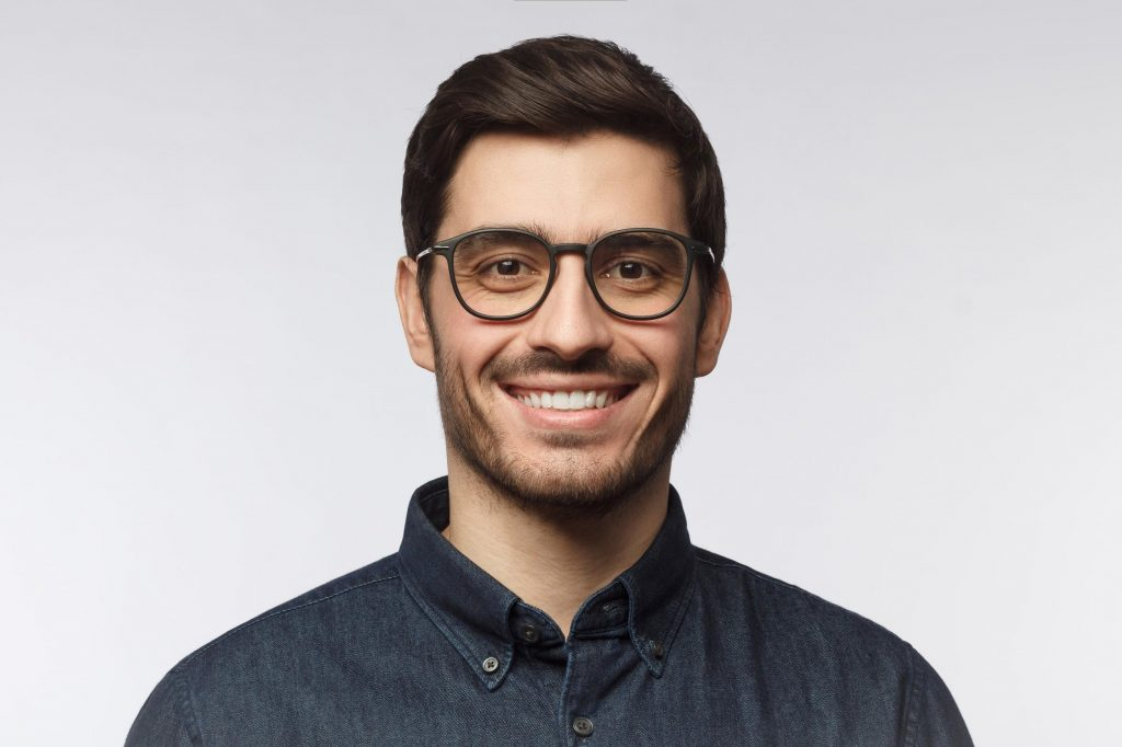 a man smiling about same-day dental treatments