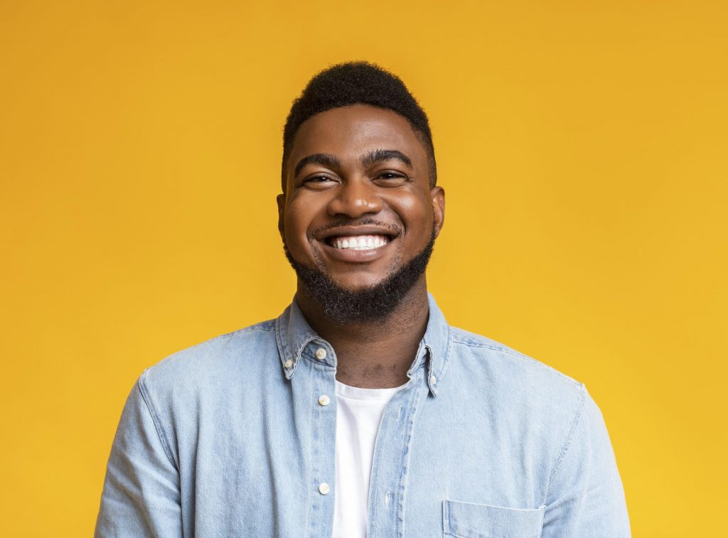 man smiling about affordable dentistry options