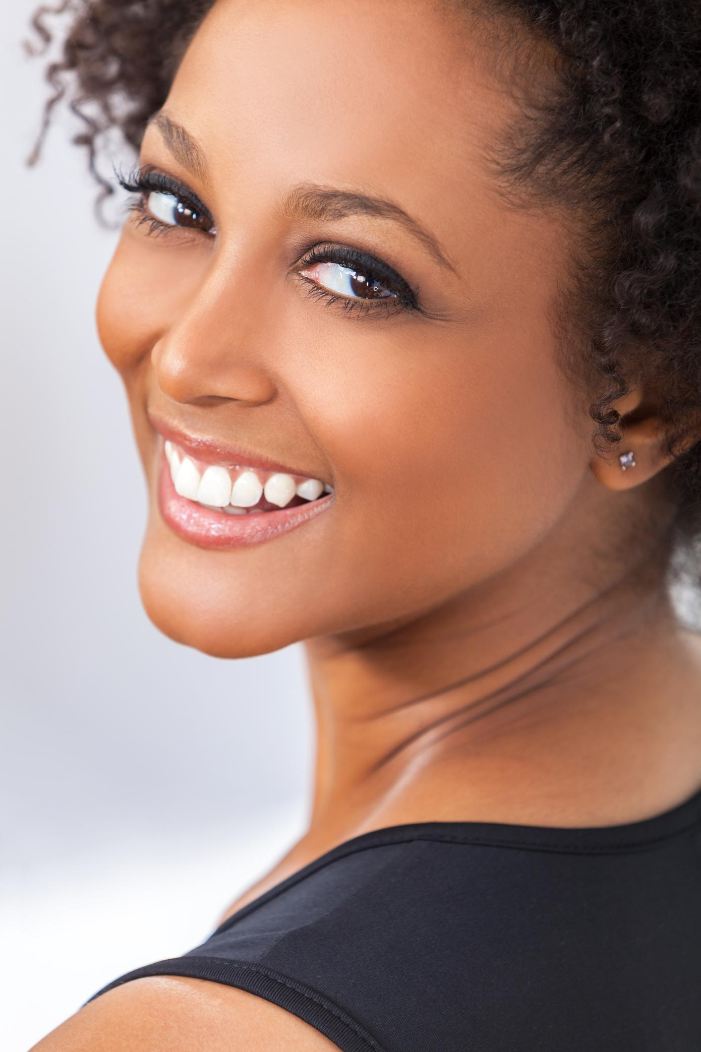 smiling woman with bridges
